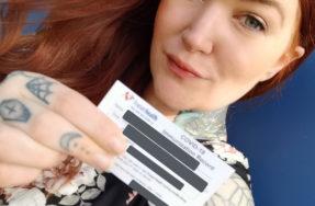 Eileen Davidson, a patient with rheumatoid arthritis, shows her COVID-19 vaccine card