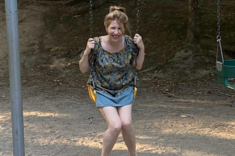 A photo of a woman, Julia Chayko, on a playground.